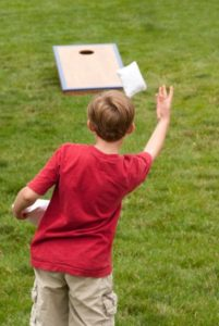 Child saying bye to school and welcoming summer camp