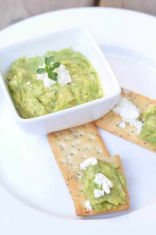 Looking for the perfect easy picnic dip recipe? This homemade guacamole with goat cheese takes about five minutes to make & tastes amazing with veggies!