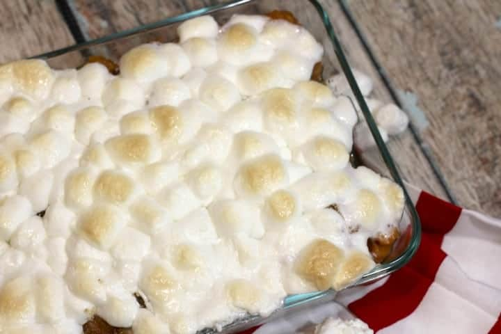 Looking for a tasty Christmas side dish recipe that will have your guests begging for more? Check out this easy Candied Sweet Potato Casserole recipe!