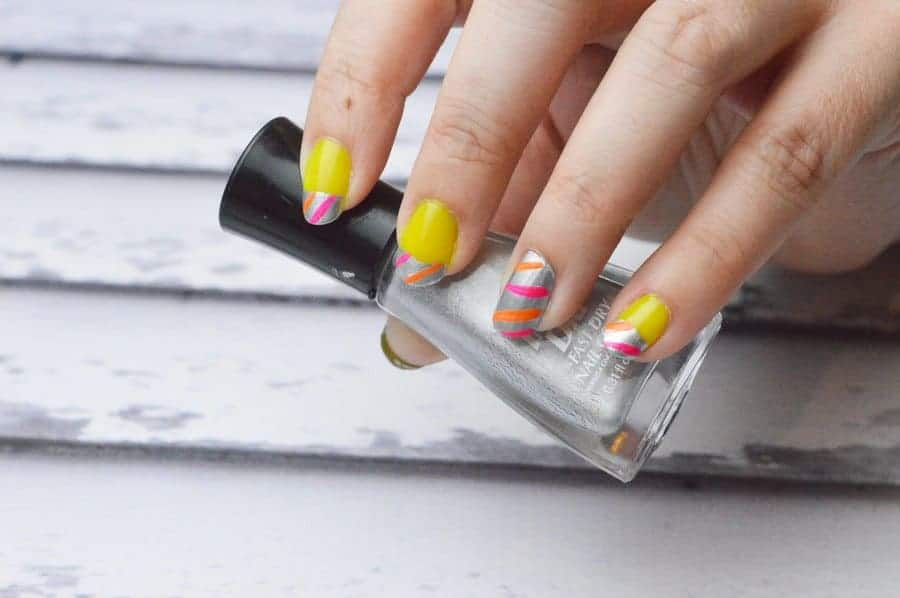 Looking for beautiful nail art that will really stand out in a crowd? Try our neon and silver striped summer nail design tutorial!