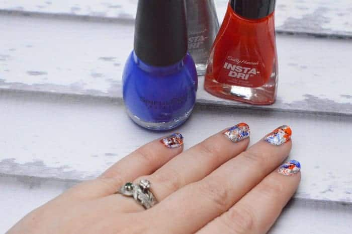The beautiful thing about this nail art design is that it's supposed to look splattered and a little messy, so you really can't make a mistake! I love all the different 4th of July nail designs out there, but some of them can get a little complicated, especially when you're short on time. These nail designs are all about easy breezy fun, just the way summer is meant to be!