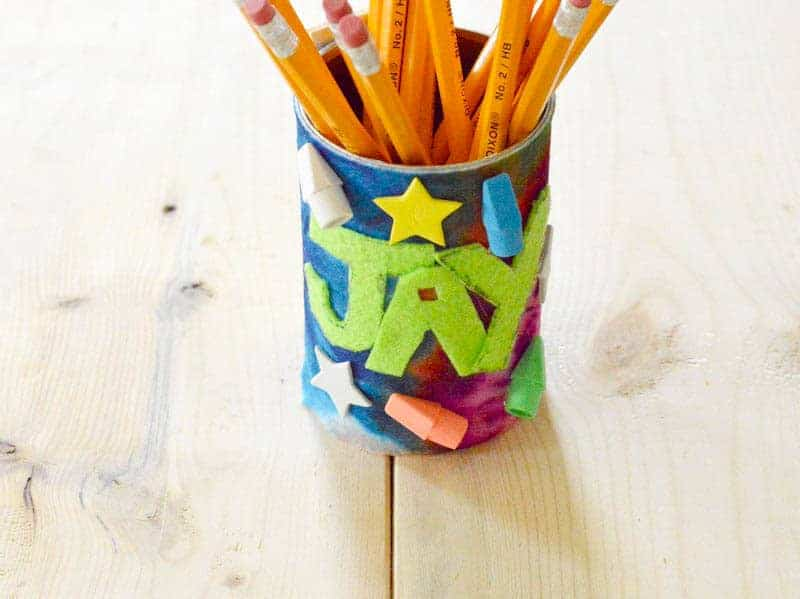 Need a fun back to school craft to get your kids excited about heading back? This DIY personalized pencil holder is as cute as it is functional!