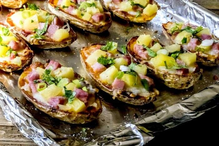 This Hawaiian potato skin recipe is a tasty gluten-free twist on Hawaiian pizza! Makes a unique Thanksgiving side dish or appetizer for your Christmas party!