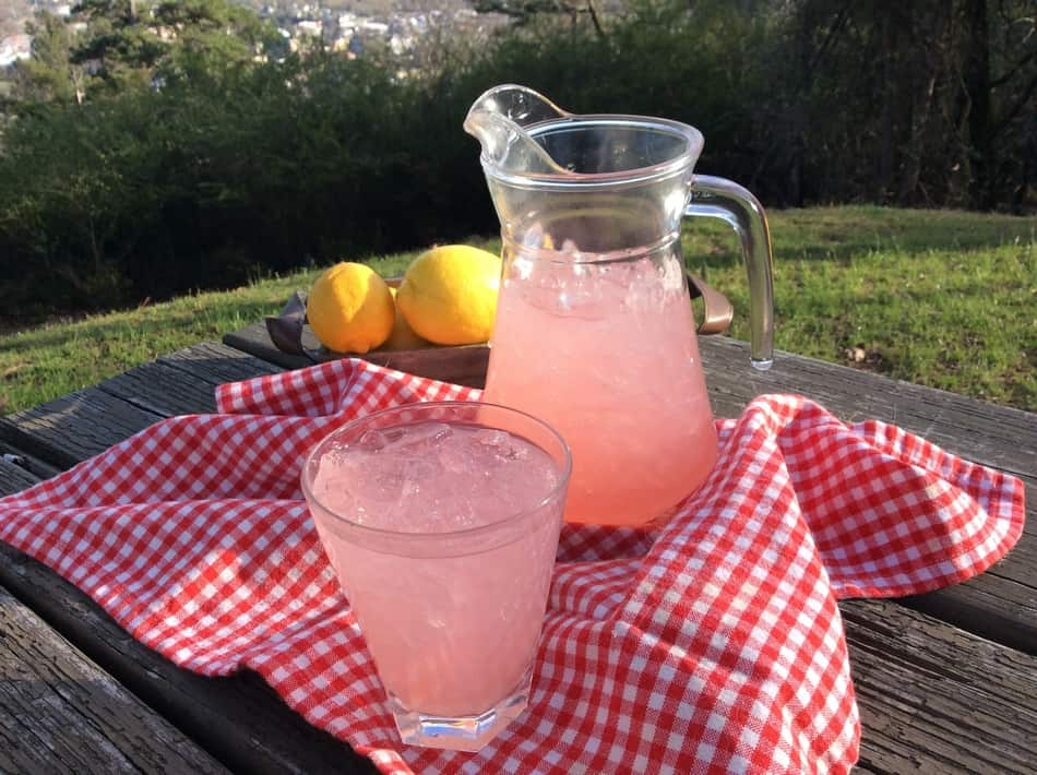 This is the yummiest pink lemonade recipe you've been craving! Perfect for summer parties or just lounging on the beach reading a good book!