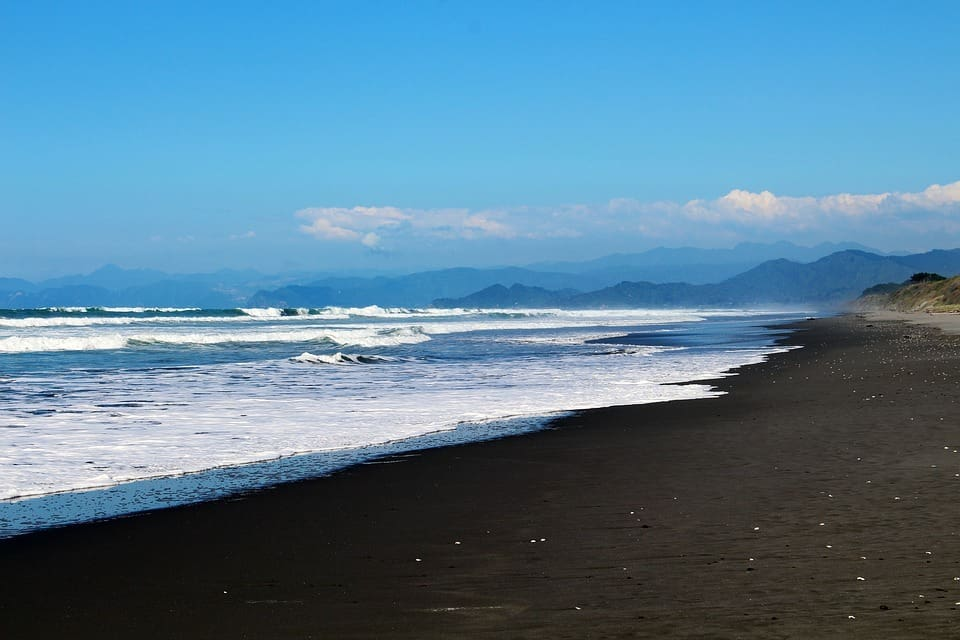 "Who said beach vacations had to involve golden fields of light sand? These 5 must-see black sand beaches will make you want to pack your bag and say ""let's go!"""